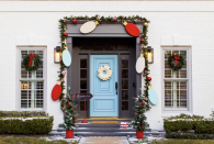 """<p>It's beginning to look a lot like <a href=""""https://www.womansday.com/christmas/"""" rel=""""nofollow noopener"""" target=""""_blank"""" data-ylk=""""slk:Christmas"""" class=""""link rapid-noclick-resp"""">Christmas</a>… from the curb, that is! There's nothing like a Christmas porch to add warmth and visual appeal during the holiday season: Decorating this special space welcomes guests, inspires you every time you come home, and shares your household's cheer with the entire neighborhood. (In fact, <em>your</em> impeccably decorated Christmas porch might even inspire a little healthy competition among neighbors, too!)</p><p>To set up the perfect outdoor space, consider your aesthetic. Do you gravitate toward timeless style and traditional appeal? Do you go for a chic, monochromatic, or understated vibe? Or are you all about making a huge visual impact with as much oversized, sparkling, and wow-worthy decor as possible?</p><p>Next, consider al the elements you have to work with for your Christmas porch. There's the front door, which stands ready for your DIY door wreath or holiday banner. Then there are the steps, planters, and seating. Don't forget the doormat!</p><p>With your porch all decked out in its holiday finery, you're ready to welcome loved ones into the home for cherished traditions like cozying up for <a href=""""https://www.womansday.com/life/entertainment/g23788700/best-christmas-movies-on-netflix/"""" rel=""""nofollow noopener"""" target=""""_blank"""" data-ylk=""""slk:Christmas movies"""" class=""""link rapid-noclick-resp"""">Christmas movies</a>, snacking on <a href=""""https://www.womansday.com/food-recipes/food-drinks/g2021/christmas-desserts/"""" rel=""""nofollow noopener"""" target=""""_blank"""" data-ylk=""""slk:Christmas desserts"""" class=""""link rapid-noclick-resp"""">Christmas desserts</a> with hot tea or cocoa, playing <a href=""""https://www.womansday.com/life/g2059/christmas-party-games/"""" rel=""""nofollow noopener"""" target=""""_blank"""" data-ylk=""""slk:Christmas party games"""" class=""""link rapid-noclick-resp"""">Christmas party games</a> in """