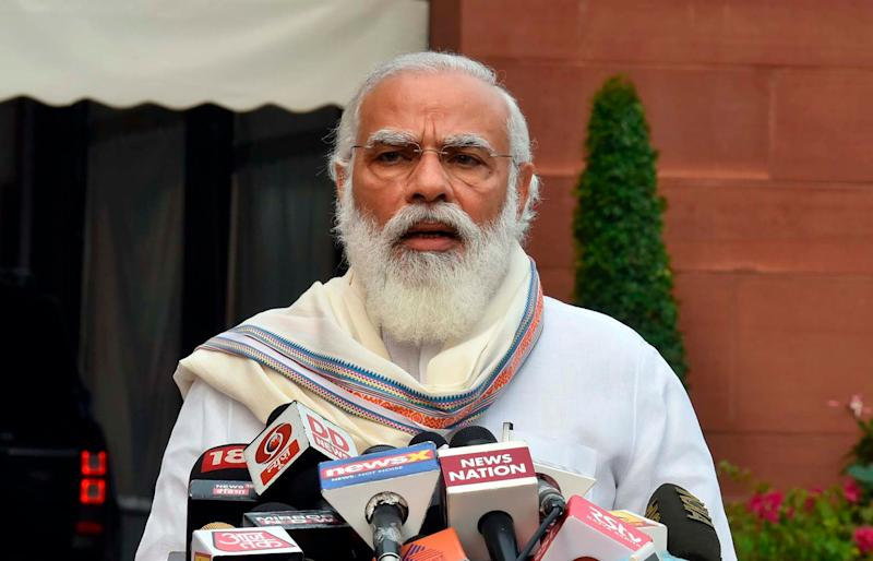 In this photo released by the Press Information Bureau, Prime Minister Narendra Modi addresses the media as he arrives at the Parliament in New Delhi, India, Monday, Sept.14, 2020. (Photo: ASSOCIATED PRESS)