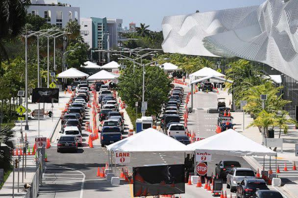 PHOTO: Cars wait in line at the Corona Virus (COVID-19) drive in testing site, set up at the Miami Beach Convention Center in Miami Beach, Fla., July 2, 2020. (Larry Marano/REX via Shutterstock)
