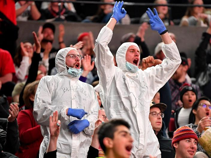 Two fans wore protective suits to a game on March 10.
