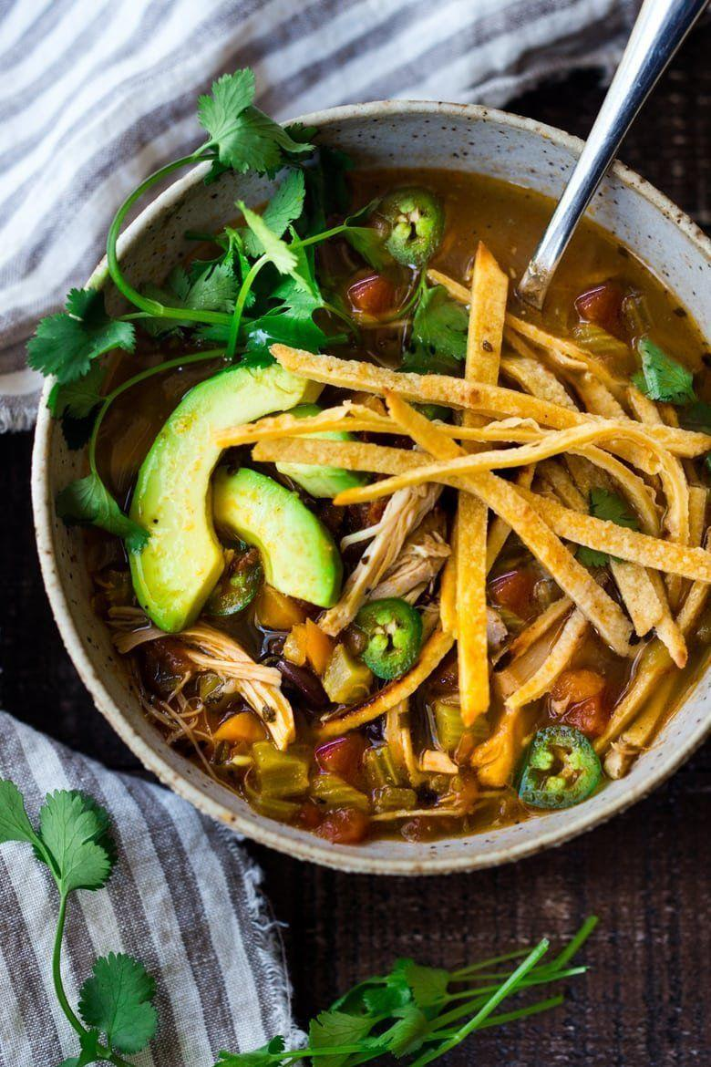 "<strong>Get the <a href=""https://www.feastingathome.com/instant-pot-chicken-tortilla-soup/"" rel=""nofollow noopener"" target=""_blank"" data-ylk=""slk:Instant Pot Chicken Tortilla Soup"" class=""link rapid-noclick-resp"">Instant Pot Chicken Tortilla Soup</a> recipe from Feasting At Home.</strong>"