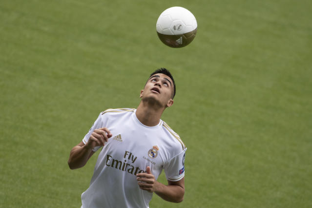 Brazilian player Rainier heads a ball during his official presentation after signing for Real Madrid at the Santiago Bernabeu stadium in Madrid, Spain, Tuesday, Feb. 18, 2020. (AP Photo/Paul White)