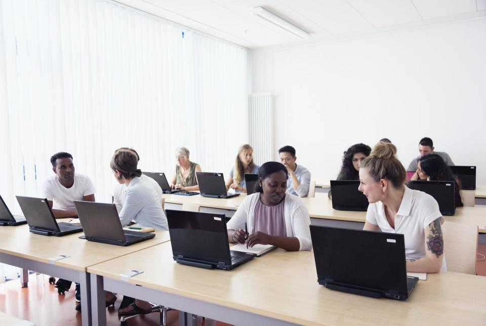 """<span class=""""caption"""">Financial concerns are a big barrier for students wishing to apply to graduate school. </span> <span class=""""attribution""""><a class=""""link rapid-noclick-resp"""" href=""""https://www.gettyimages.com/detail/photo/training-class-students-learning-at-pc-discussion-royalty-free-image/607900886?adppopup=true"""" rel=""""nofollow noopener"""" target=""""_blank"""" data-ylk=""""slk:SilviaJansen/E+ via Getty Images"""">SilviaJansen/E+ via Getty Images</a></span>"""