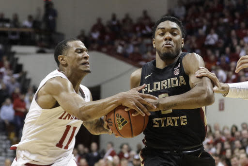 Florida State's Trent Forrest (3) is defended by Indiana's Devonte Green (11) during the second half of an NCAA college basketball game Tuesday, Dec. 3, 2019, in Bloomington, Ind. Indiana won 80-64. (AP Photo/Darron Cummings)
