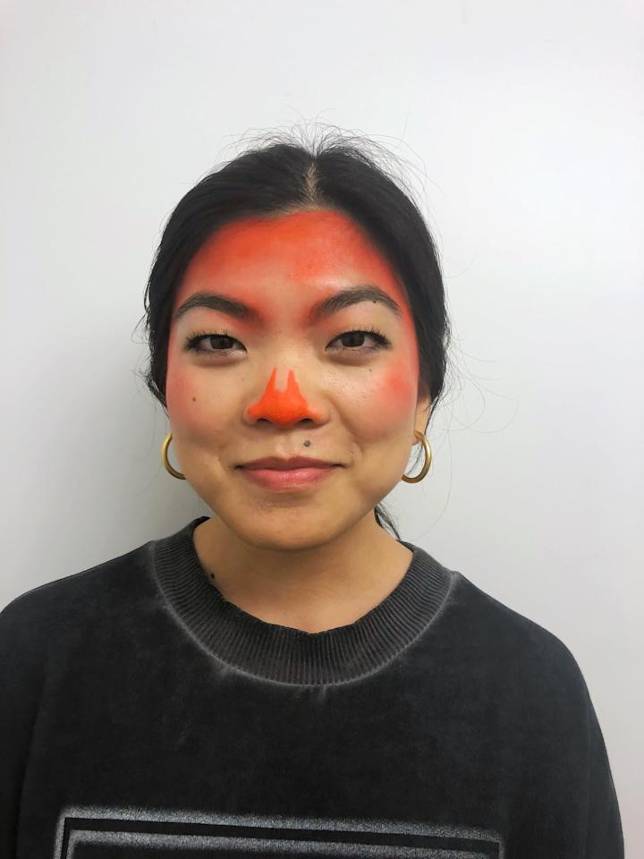 "<p>Using a damp cosmetics sponge and an orange liquid lipstick like <a href=""https://www.popsugar.com/buy/Kat-Von-D-Everlasting-Lipstick--Go-Go-372979?p_name=Kat%20Von%20D%20Everlasting%20Lipstick%20in%20A-Go-Go&retailer=sephora.com&pid=372979&price=20&evar1=bella%3Aus&evar9=45387606&evar98=https%3A%2F%2Fwww.popsugar.com%2Fbeauty%2Fphoto-gallery%2F45387606%2Fimage%2F45387607%2FStep-1-Add-Orange&list1=makeup%2Challoween%2Cbeauty%20shopping%2Cmakeup%20tutorials%2Challoween%20beauty%2Challoween%20costumes%202018&prop13=api&pdata=1"" rel=""nofollow"" data-shoppable-link=""1"" target=""_blank"" class=""ga-track"" data-ga-category=""Related"" data-ga-label=""https://www.sephora.com/product/everlasting-love-liquid-lipstick-P384954?skuId=1552447&amp;icid2=products%20grid:p384954:product"" data-ga-action=""In-Line Links"">Kat Von D Everlasting Lipstick in A-Go-Go </a> ($20), apply the liquid along your hairline and temples, and blend toward the center of your face. Work in small sections to ensure the liquid doesn't dry down before you're able to blend it out. Add a little to your cheeks, and draw on a jack-o'-lantern nose using a coordinating lip liner like the <a href=""https://www.popsugar.com/buy/Everlasting-Lip-Liner-372980?p_name=Everlasting%20Lip%20Liner&retailer=sephora.com&pid=372980&price=18&evar1=bella%3Aus&evar9=45387606&evar98=https%3A%2F%2Fwww.popsugar.com%2Fbeauty%2Fphoto-gallery%2F45387606%2Fimage%2F45387607%2FStep-1-Add-Orange&list1=makeup%2Challoween%2Cbeauty%20shopping%2Cmakeup%20tutorials%2Challoween%20beauty%2Challoween%20costumes%202018&prop13=api&pdata=1"" rel=""nofollow"" data-shoppable-link=""1"" target=""_blank"" class=""ga-track"" data-ga-category=""Related"" data-ga-label=""https://www.sephora.com/product/everlasting-lip-liner-P418804?icid2=products%20grid:p418804:product"" data-ga-action=""In-Line Links"">Everlasting Lip Liner</a> ($18).</p>"