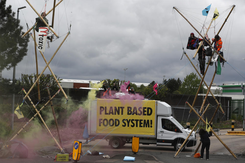 COVENTRY, ENGLAND - MAY 22: Animal rights protesters from Animal Rebellion blockade a McDonald's distribution centre to stop deliveries to the fast-food chain's 1,300 UK outlets on May 22, 2021 in Coventry, England. Animal Rebellion said about 50 activists were using trucks and bamboo structures to stop lorries leaving depots in Hemel Hempstead, Basingstoke, Coventry and Heywood, Greater Manchester.  (Photo by Darren Staples/Getty Images)