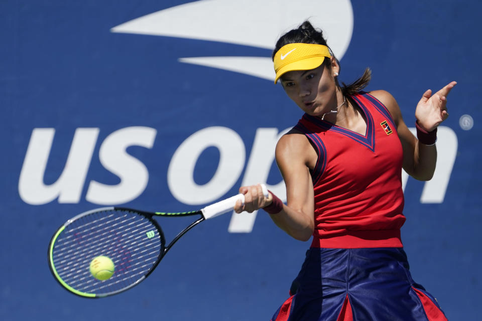 Emma Raducanu, from Britain, hits a forehand to Shuai Zhang, of China,during the second round of the US Open tennis championships, Thursday, Sept. 2, 2021, (AP Photo/Seth Wenig)