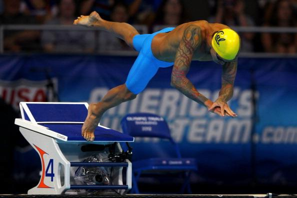 Anthony Ervin dives off of the starting block at the start of the championship final of the Men's 50 m Freestyle during Day Seven of the 2012 U.S. Olympic Swimming Team Trials at CenturyLink Center on July 1, 2012 in Omaha, Nebraska. (Photo by Al Bello/Getty Images)