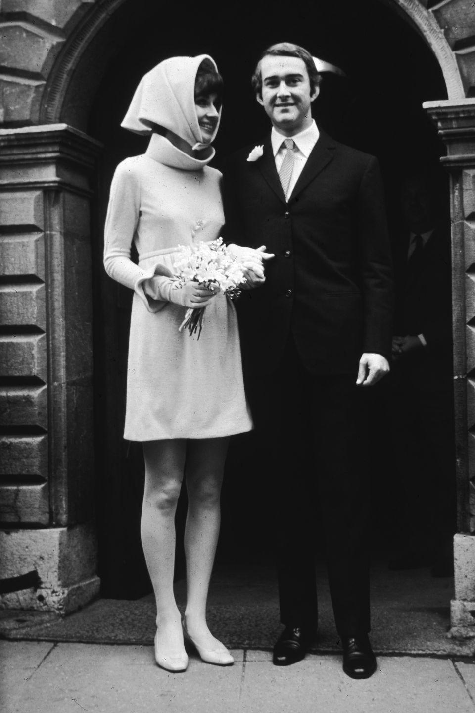 <p>For her second marriage to Italian psychiatrist, Andrea Dotti, Hepburn wore a pale pink mini dress and matching headscarf at a town hall in Switzerland. </p>