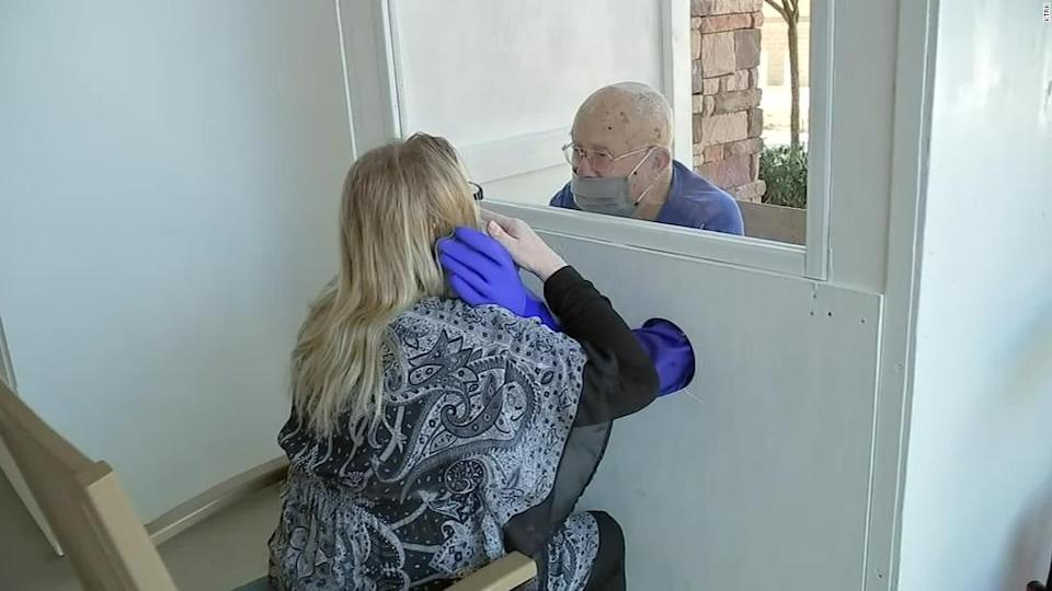 """<p>A resident of a Texas assisted living facility embraces a loved one using the 'hug booth.'</p><div class=""""cnn--image__credit""""><em><small>Credit: KTRK / KTRK</small></em></div>"""