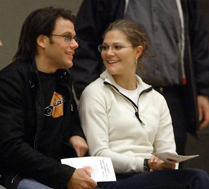 <p>At a basketball game with Swedish Crown Princess Victoria, who he met while working as her trainer. </p>