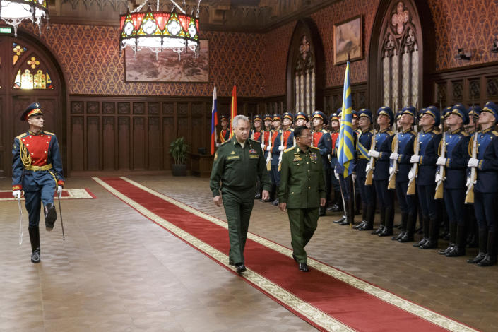 Russian Defense Minister Sergei Shoigu, left, and Commander-in-Chief of Myanmar's armed forces Senior General Min Aung Hlaing walk past the honor guard prior to their talks in Moscow, Russia, Tuesday, June 22, 2021. (Vadim Savitskiy/Russian Defense Ministry Press Service via AP)