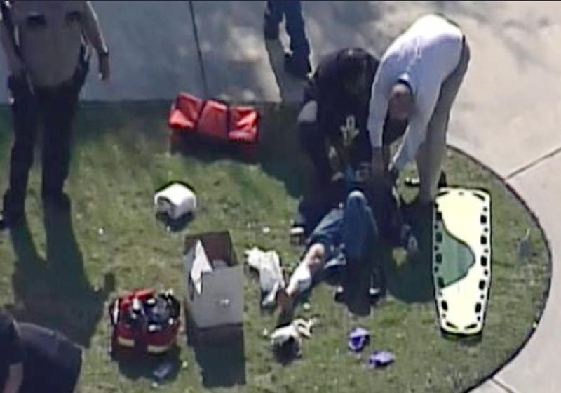 In this frame grab provided by KPRC Houston, an unidentified person is attended to by emergency personnel at Lone Star College Tuesday, Jan. 22, 2013, in Houston, where law enforcement officials say the community college is on lockdown amid reports of a shooter on campus.  (AP Photo/Courtesy KPRC TV) MANDATORY CREDIT