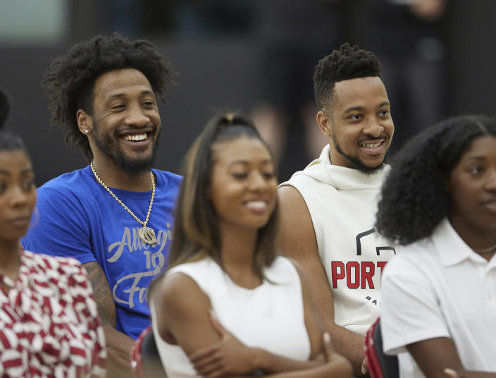 Portland Trail Blazers players Robert Covington, left, and CJ McCollum smile during a press conference announcing Chauncey Billups as the head coach of the at the team's practice facility in Tualatin, Ore., Tuesday, June 29, 2021. (AP Photo/Craig Mitchelldyer)