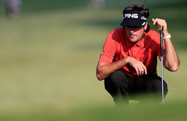 ATLANTA, GA - SEPTEMBER 22: Bubba Watson lines up a putt during the third round of the TOUR Championship by Coca-Cola at East Lake Golf Club on September 22, 2012 in Atlanta, Georgia. (Photo by Sam Greenwood/Getty Images)