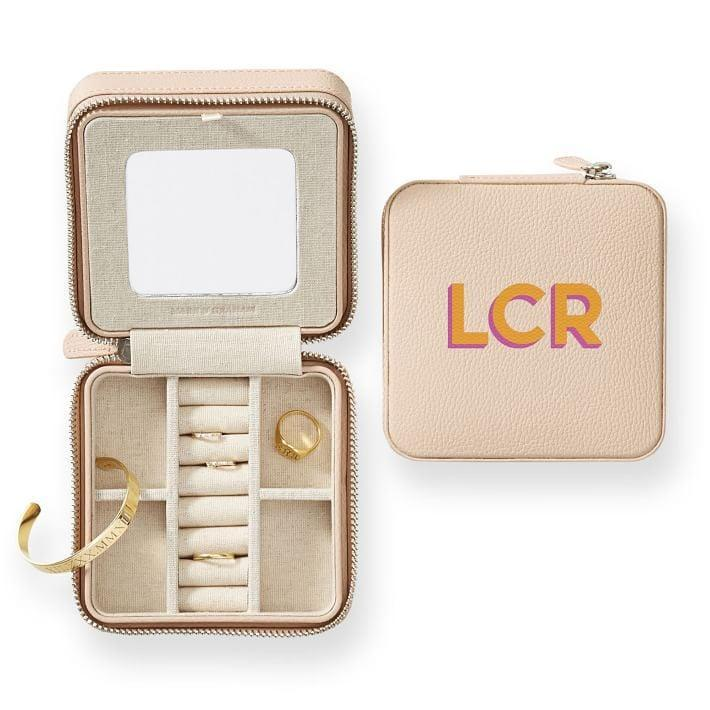 <p>She'll take this <span>Mark &amp; Graham Monogram Jewelry Case</span> ($69) on all her trips.</p>