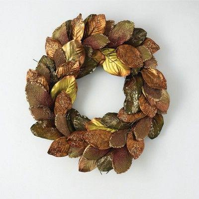 """<p><strong>Sullivans</strong></p><p>target.com</p><p><strong>$88.99</strong></p><p><a href=""""https://www.target.com/p/sullivans-magnolia-leaf-artificial-wreath-30-h-brown/-/A-83656833"""" rel=""""nofollow noopener"""" target=""""_blank"""" data-ylk=""""slk:BUY NOW"""" class=""""link rapid-noclick-resp"""">BUY NOW</a></p><p>Add a little shimmer to your season's front door without having to get out the rake.</p>"""