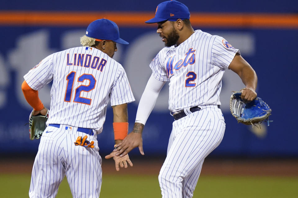 New York Mets' Francisco Lindor (12) celebrates with Dominic Smith after the team's baseball game against the Chicago Cubs on Tuesday, June 15, 2021, in New York. The Mets won 3-2. (AP Photo/Frank Franklin II)
