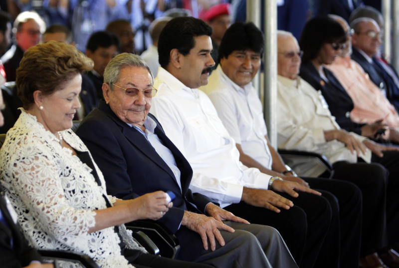 """From left to right: Brazil's President Dilma Rousseff, left, Cuba's President Raul Castro, Venezuela's President Nicolas Maduro, Bolivia's President Evo Morales attend the inauguration ceremony of the first phase of a port overhaul project in Mariel, Cuba, Monday, Jan. 27, 2014. The new port will be able to accommodate deeper-drafting """"post-Panamax"""" ships that will begin crossing the Panama Canal once an expansion project there is completed in the next year or so.(AP Photo/Ismael Francisco, Cubadebate)"""