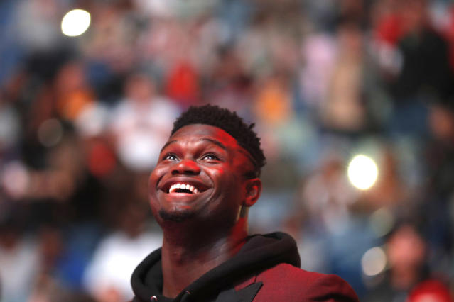 New Orleans Pelicans forward Zion Williamson watches the video screen during a player introduction video before the team's NBA basketball game against the Denver Nuggets in New Orleans, Thursday, Oct. 31, 2019. The rookie first-round draft pick is recovering from knee surgery. (AP Photo/Gerald Herbert)