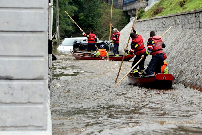 Image: Austrian firefighters steer a boat through a flooded street in Pepinster, Belgium on July 16, 2021, where the situation remains critical after heavy rains the previous days.  (François Walschaerts / AFP - Getty Images)