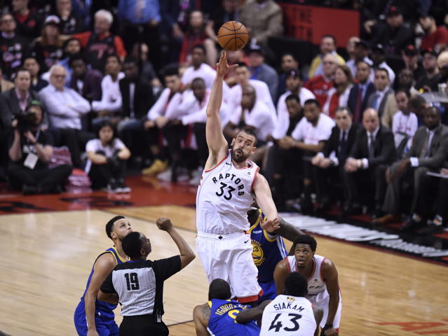 Toronto Raptors center Marc Gasol (33) leaps for the tipoff during the first half of Game 1 of the team's basketball's NBA Finals against the Golden State Warriors, Thursday, May 30, 2019, in Toronto. (Frank Gunn/The Canadian Press via AP)