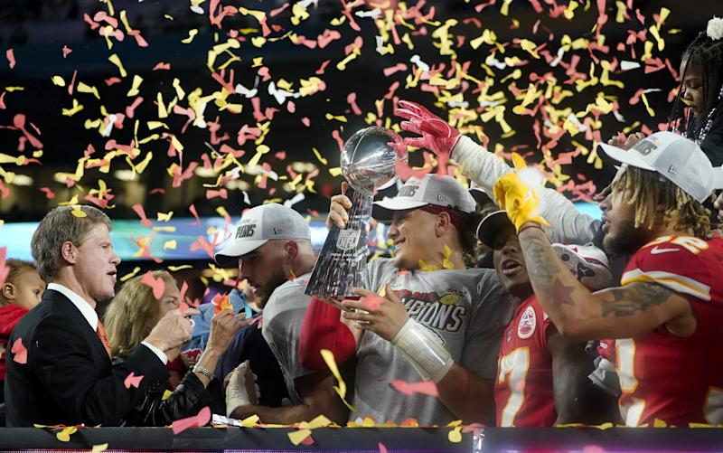 (L-R) CEO of the Kansas City Chiefs Clark Hunt, Tight End Travis Kelce, Quarterback Patrick Mahomes (holding the Lombardi trophy), Wide receiver Mecole Hardman and Strong safety Tyrann Mathieu celebrate after winning Super Bowl LIV between the Kansas City Chiefs and the San Francisco 49ers at Hard Rock Stadium in Miami Gardens, Florida, on February 2, 2020. (Photo by TIMOTHY A. CLARY / AFP) (Photo by TIMOTHY A. CLARY/AFP via Getty Images)