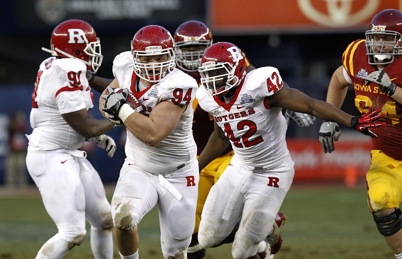 NEW YORK - DECEMBER 30:  Scott Vallone #94 of the Rutgers Scarlet Knights runs for the endzone afte recovering a fumble against the Iowa State Cyclones during the New Era Pinstripe Bowl at Yankee Stadium on December 30, 2011 in the Bronx Borough of New York City.  (Photo by Jeff Zelevansky/Getty Images)