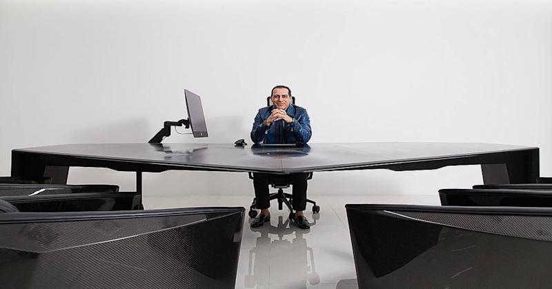 Manny Khoshbin and 1,400 pound black aluminum office desk