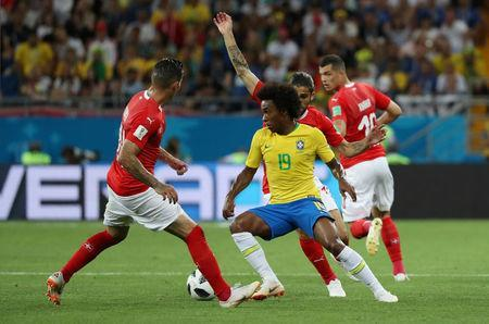 Soccer Football - World Cup - Group E - Brazil vs Switzerland - Rostov Arena, Rostov-on-Don, Russia - June 17, 2018 Brazil's Marcelo in action with Switzerland's Ricardo Rodriguez and Steven Zuber REUTERS/Marko Djurica