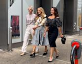 <p>For their first day of filming the three leading ladies wore these complementary looks; Cynthia Nixon in a checked shirt and Vince trousers, Sarah Jessica Parker in a Norma Kamali skirt and Celine platforms, and Kristin Davis in a Carolina Herrera top and Dior heels. </p>