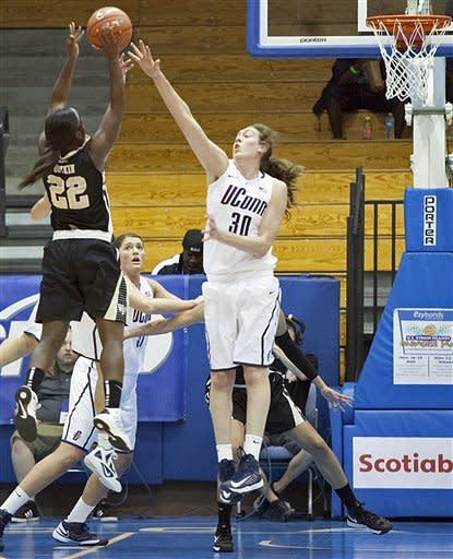 Wake Forrest's guard Lakevia Boykin, left, shoots for the basket over the defense of Connecticut's forward Breanna Stewart during the first half of an NCAA women's college basketball game in St. Thomas, U.S. Virgin Islands, Thursday, Nov. 22, 2012. (AP Photo/Thomas Layer)