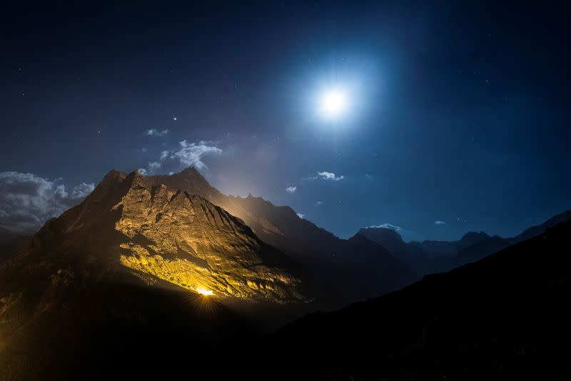The mountain chains of Veisivi and Dent de Perroc are illuminated to celebrate Swiss National Day in Evolene