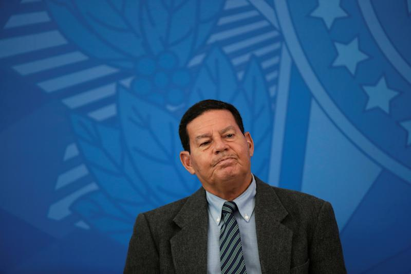 Brazil's Vice-President Hamilton Mourao reacts during the swearing-in ceremony of Brazil's new Health Minister Nelson Teich, at Planalto Palace in Brasilia, amid coronavirus disease (COVID-19) outbreak, in Brasilia, Brazil, April 17, 2020. REUTERS/Ueslei Marcelino