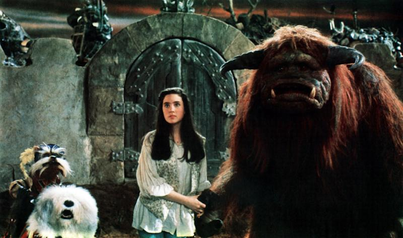 'Labyrinth' star Jennifer Connelly stands between Jim Henson Creature Shop created puppets Sir Didymus (left) and Ludo (right). (Photo: TriStar Pictures/Courtesy Everett Collection)