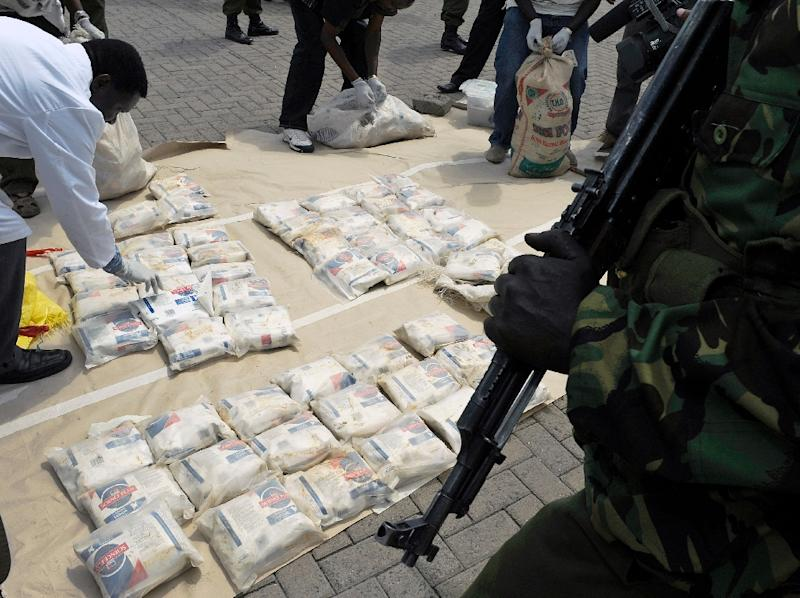 Kenyan police officers display bags of heroin at the Wilson airport in Nairobi after a heroin drug bust in the coastal town of Mombasa on March 25, 2011