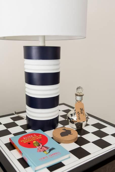 <p>You'll find little nods to<em> Alice in Wonderland</em> throughout the home, like this checkerboard table. (Airbnb) </p>