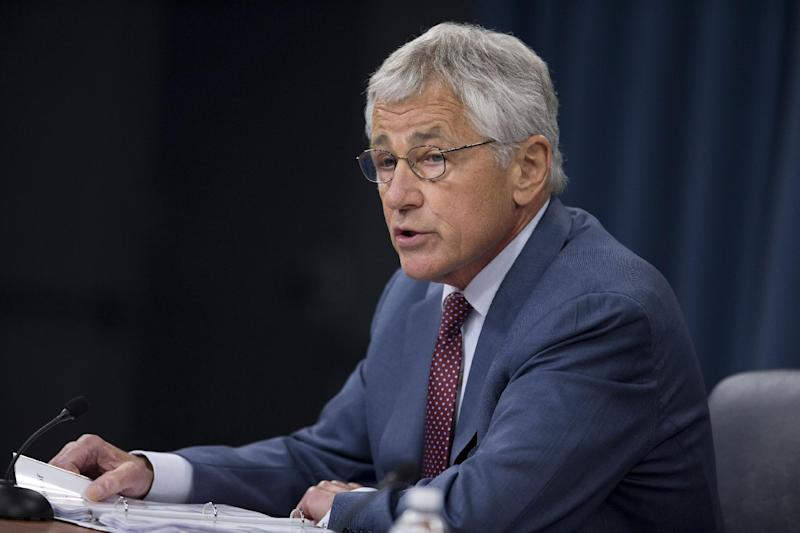 Defense Secretary Chuck Hagel speaks during a news conference at the Pentagon, Wednesday, July 31, 2013. Hagel warned that the Pentagon may have to mothball up to three Navy aircraft carriers and order more sharp reductions in the size of the Army and Marine Corps if Congress does not act to avoid massive budget cuts beginning in 2014. (AP Photo/Evan Vucci)