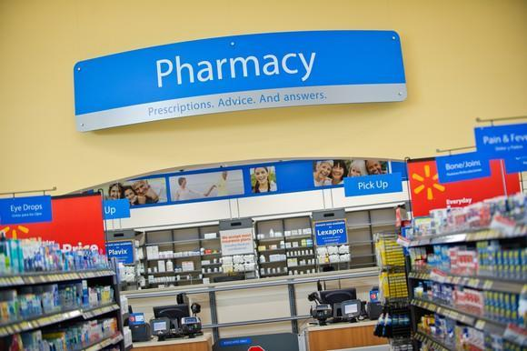 A panorama of Walmart's pharmacy section with pick-up counter.