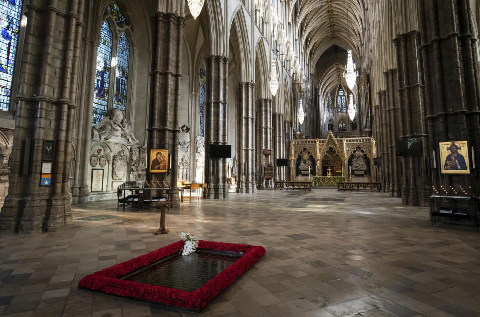 The bouquet of flowers placed by The Queen's Equerry, Lieutenant Colonel Nana Kofi Twumasi-Ankrah, on behalf of Queen Elizabeth II , during a ceremony to mark the centenary of the burial of the Unknown Warrior, in Westminster Abbey, London, Wednesday, Nov. 4, 2020. Queen Elizabeth II donned a face mask in public for the first time during the coronavirus pandemic when attending a brief ceremony at Westminster Abbey last week to mark the centenary of the burial of the Unknown Warrior. While the 94-year-old has been seen in public on several occasions over the past few months, she has not worn a face covering. (Aaron Chown/Pool Photo via AP)
