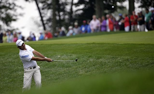 Jason Day, of Australia, hits from rough on the 10th hole during the second round of the PGA Championship golf tournament at Valhalla Golf Club on Friday, Aug. 8, 2014, in Louisville, Ky. (AP Photo/David J. Phillip)