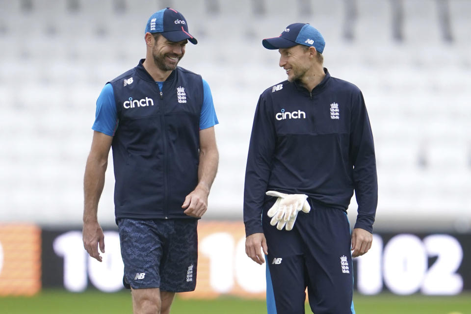 England's Joe Root, right, reacts with bowler James Anderson during a nets session before the 3rd Test cricket match between England and India at Headingley cricket ground in Leeds, England, Tuesday, Aug. 24, 2021. (AP Photo/Jon Super)