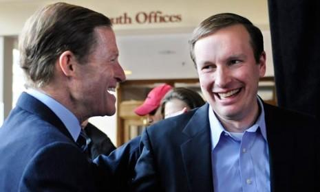 Democrat Chris Murphy (right) shakes hands with Sen. Richard Blumenthal (D-Conn.) at a rally in Hartford, Conn. on Nov. 5: Murphy has joined Blumenthal as a Democrat who body-slammed Linda McMahon in a U.S. Senate race.