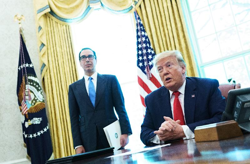 US President Donald Trump speaks before signing  an executive order for sanctions on Iran's supreme leader; behind him is Treasury Secretary Steven Mnuchin