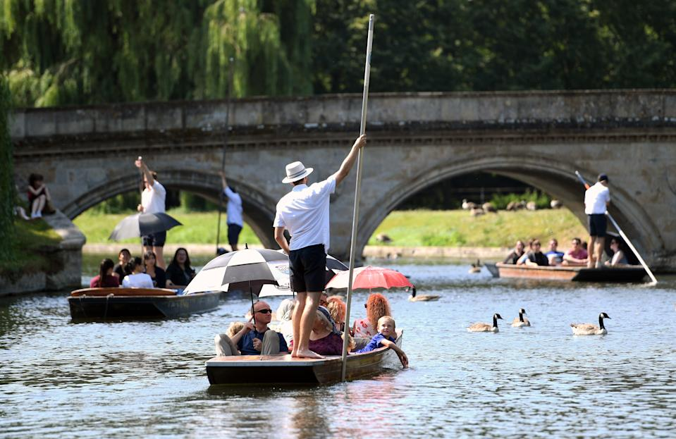 People punt along the River Cam in Cambridge, as the UK could encounter the hottest July day on record later this afternoon.
