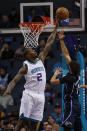 Charlotte Hornets forward Marvin Williams, left, blocks the shot by Orlando Magic guard Michael Carter-Williams in the first half of an NBA basketball game in Charlotte, N.C., Monday, Feb. 3, 2020. (AP Photo/Nell Redmond)