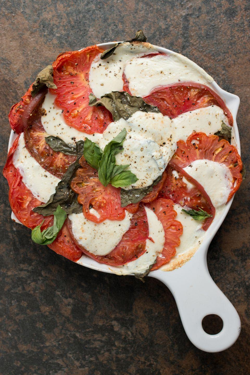 "<p>We've all enjoyed a traditional Caprese salad with layered mozzarella and tomatoes, a hint of basil, and balsamic vinaigrette. You may think there is no improving on perfection, but this is a slightly new take, a hot one, in casserole form, and believe me when I tell you there is a time and place for both the traditional and this twist!</p><p>Get the recipe from <a href=""https://www.delish.com/cooking/recipe-ideas/recipes/a54333/caprese-quinoa-casserole-recipe/"" rel=""nofollow noopener"" target=""_blank"" data-ylk=""slk:Delish"" class=""link rapid-noclick-resp"">Delish</a>.</p>"
