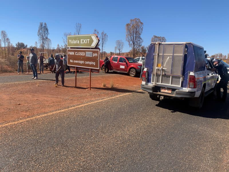 People block entry to Uluru-Kata Tjuta National Park to visitors from coronavirus hotspots, in Uluru-Kata Tjuta National Park