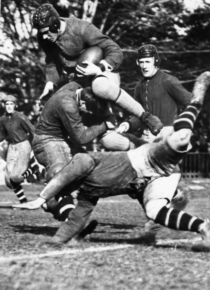 DECEMBER 4, 1909 -- FIRST GREY CUP -- Victorious University of Toronto Varsity Blues' Smirle Lawson carries ball in first Grey Cup game in 1909. The Blues defeated the Toronto Parkdale Canoe Club at Rosedale Field by a score of 26-6.
