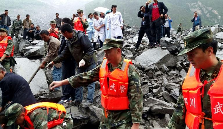 Almost  100 remain missing after deadly China landslide